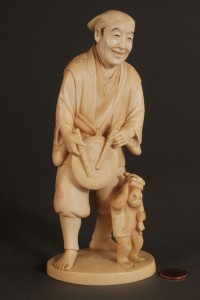 Lot 269: Asian Ivory figure, Musician with Monkey