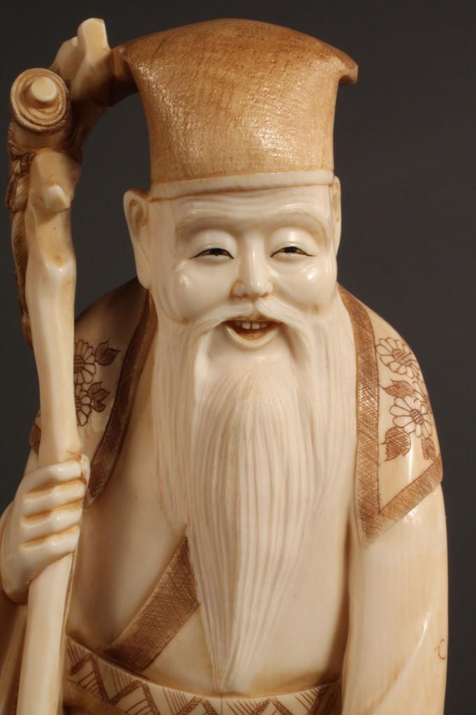 Lot 270: Asian Ivory figure, Scholar holding staff