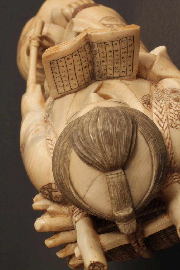 Lot 273: Asian Ivory figure, Peasant with wood basket & book