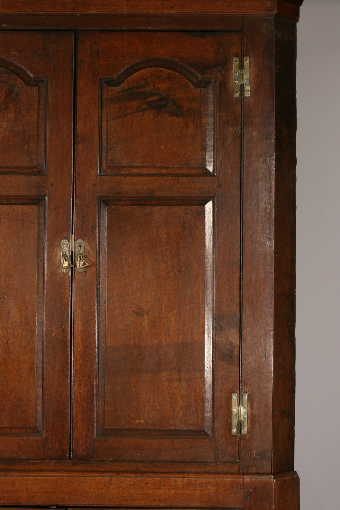 Lot 304: George III oak corner cupboard