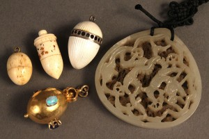Lot 372: Four pendant charms & a carved jade pendant