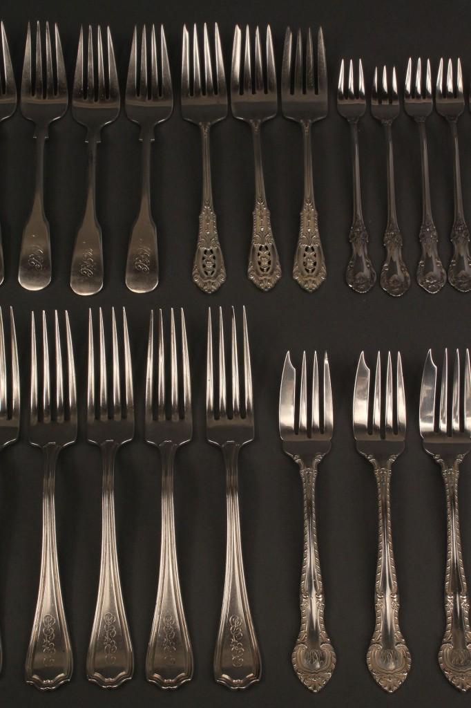 Lot 408: Lot of 27 sterling silver forks, assorted patterns