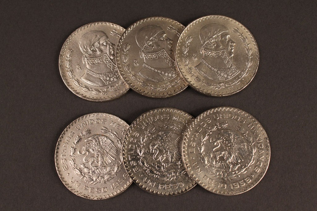 Lot 414: Lot of 245 Silver Mexican Pesos