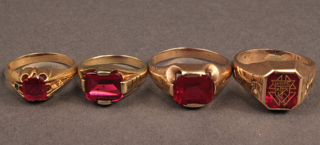 Lot 485: Lot of 4 Gold Rings w/ Red Stones
