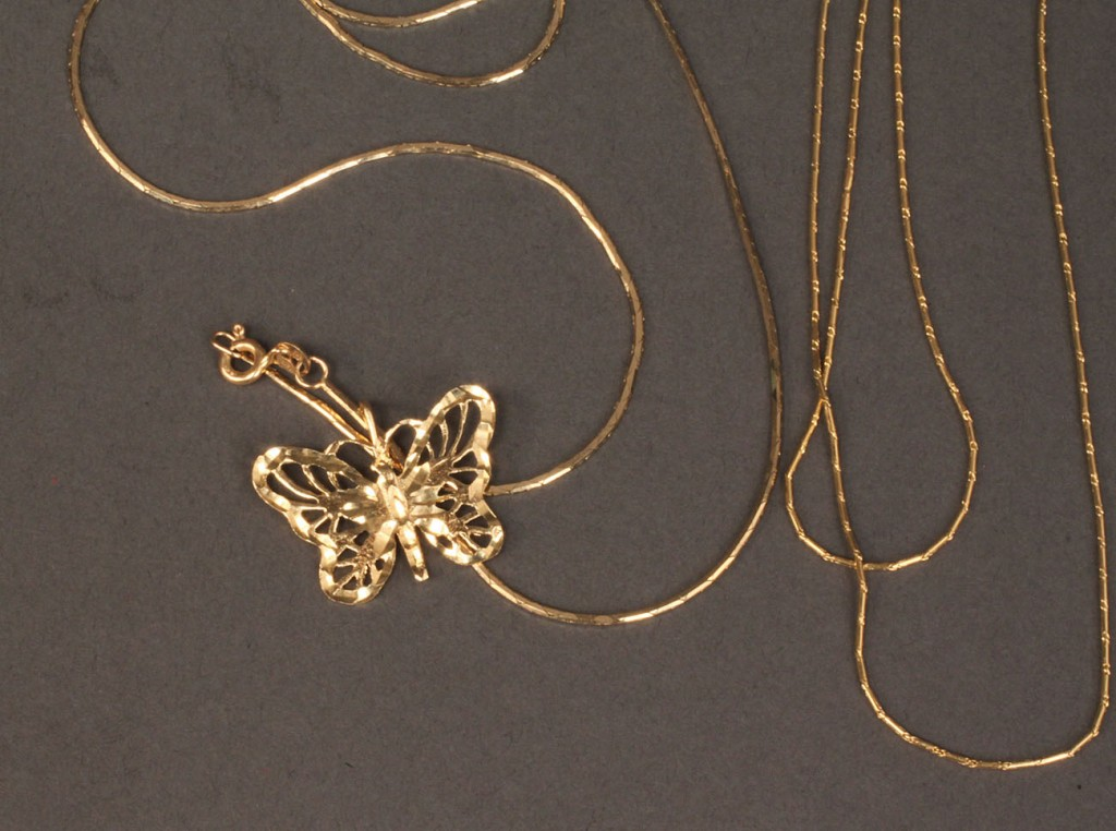 Lot 486: Lot of 14K jewelry: butterfly pendant & 3 chains