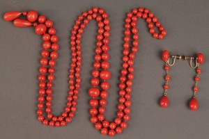 "Lot 490: Red coral necklace, 54"", and earrings"