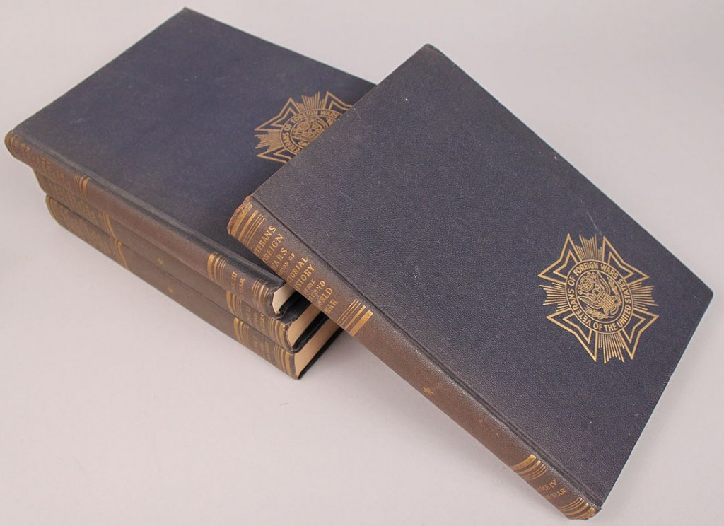 Lot 587: WWII era related books & bookends, 8 pcs.