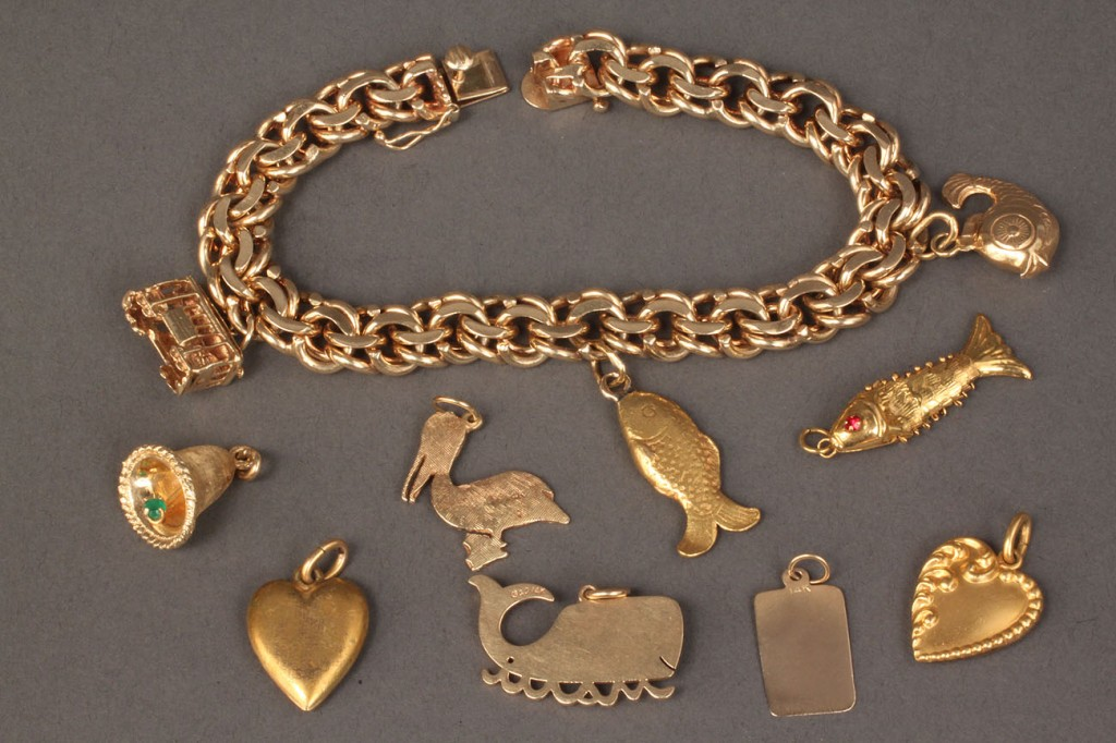 Lot 96: 14K gold link charm bracelet with 10 charms