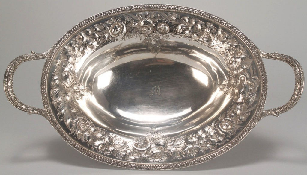 Lot 115: Coin silver repousse cake basket