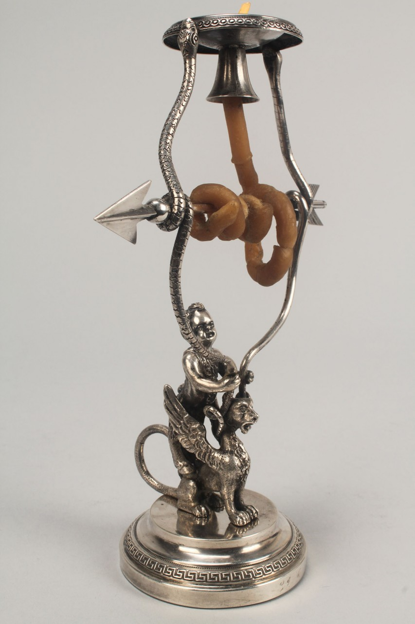 Lot 137: Figural silver wax jack candlestick w/ faun & grif