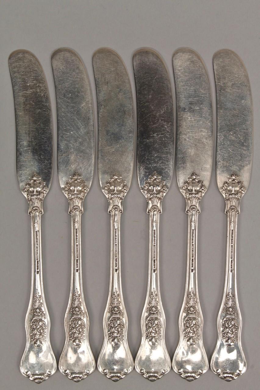 Lot 146: Six Tiffany flat handle butter speaders