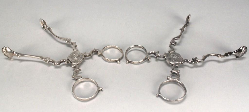 Lot 149: Two pairs George III silver sugar nips
