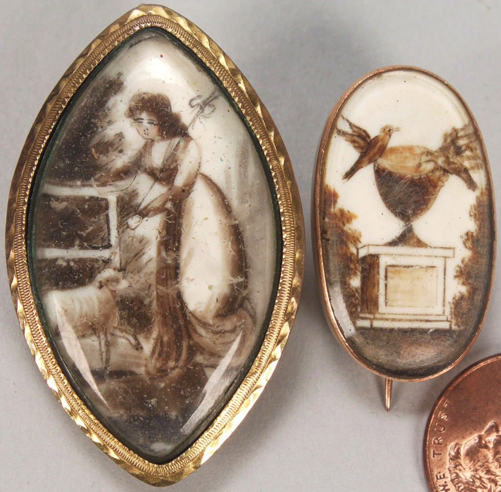 Lot 162: Two sepia miniature brooches, mourning scenes