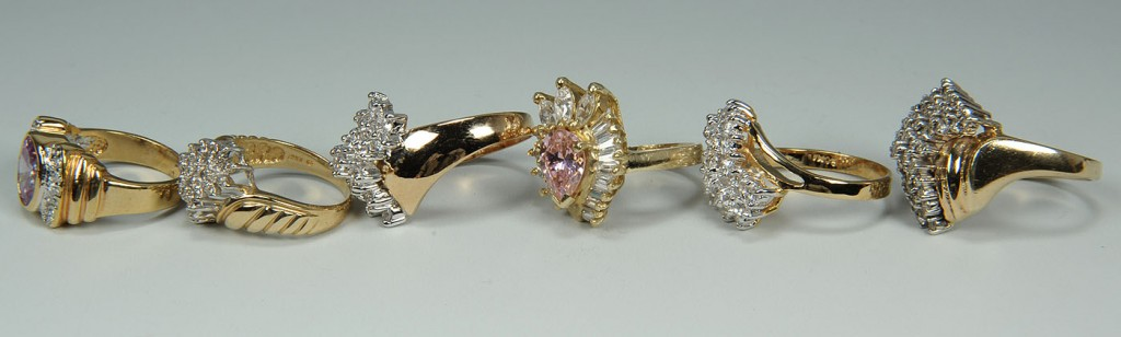 Lot 168: Group of six 10K yellow gold rings, four with diam
