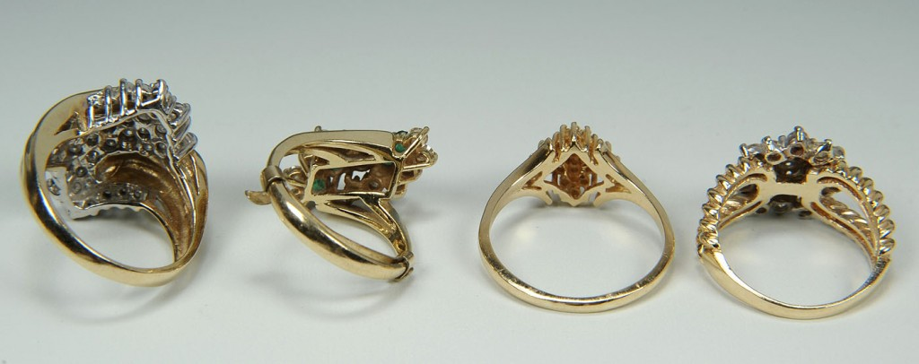 Lot 169: Four 14K yellow gold diamond cluster rings