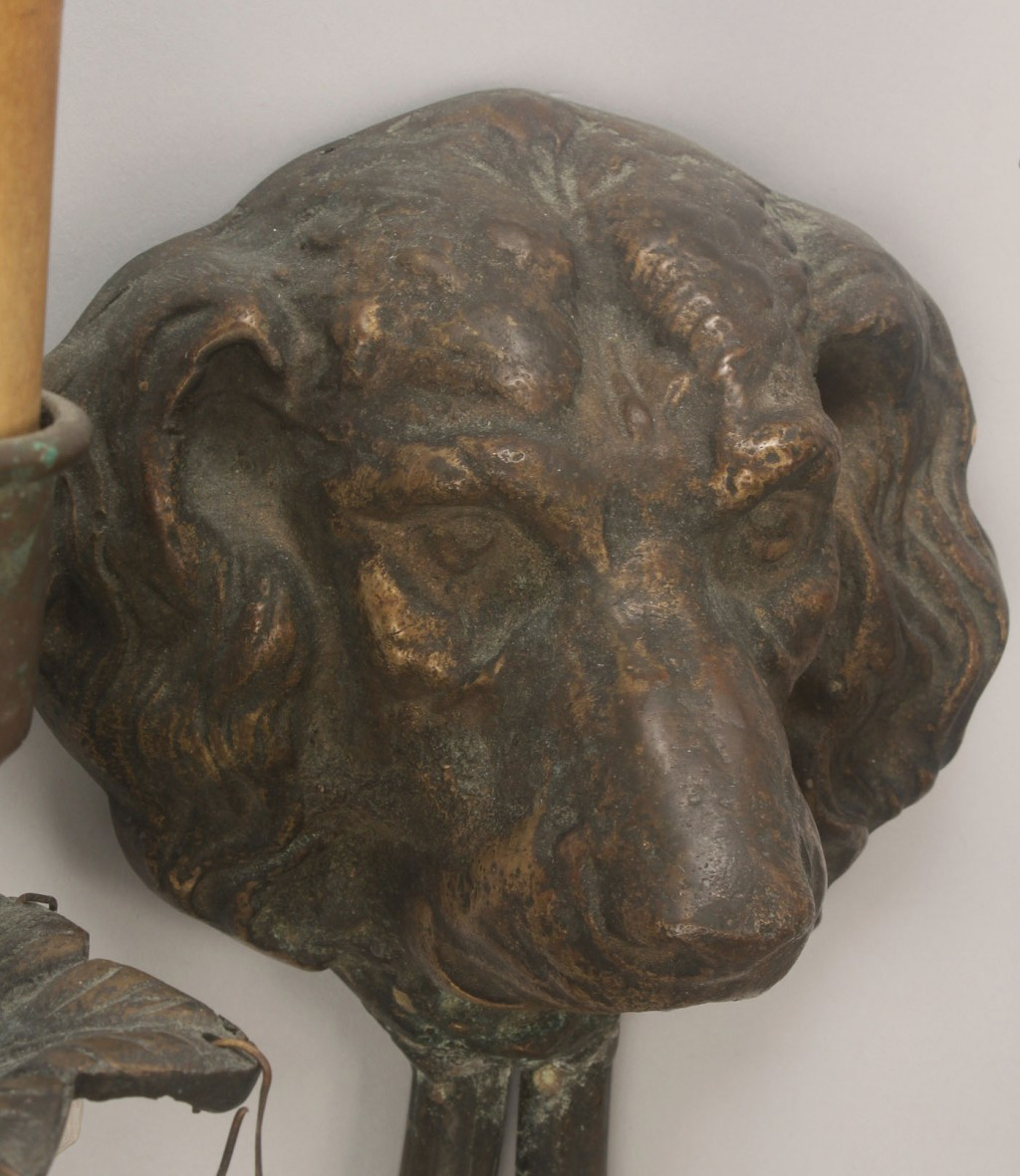 Lot 313: Pair of bronze dog head sconces