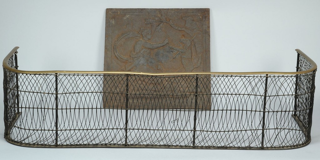 Lot 314: 18th c. Wirework fender & Cast Iron Stove plate