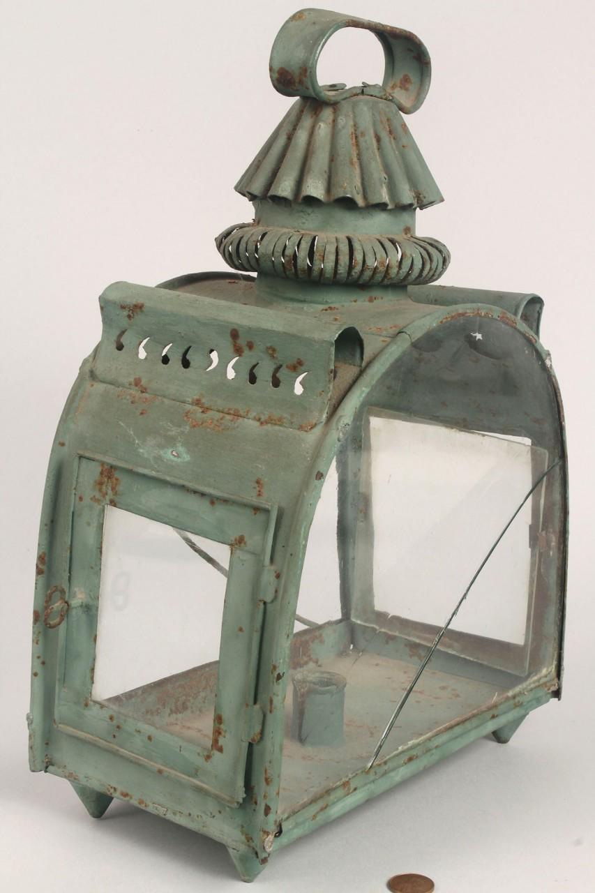 Lot 316: Green tin lantern, pierced sun and moon