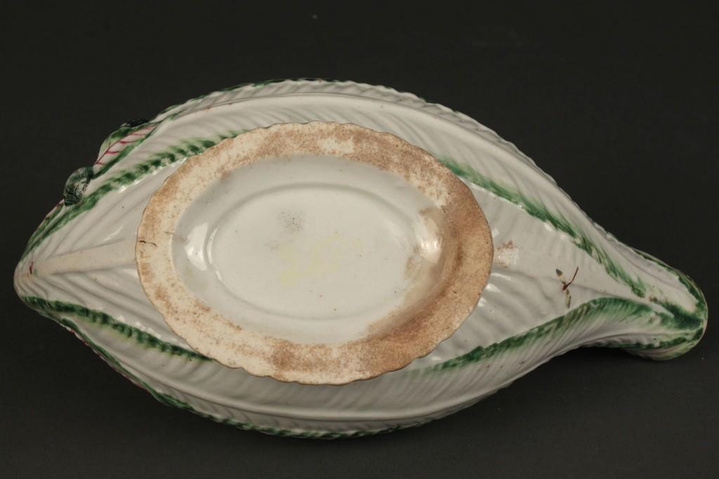 Lot 353: Porcelain sauce boat, Chelsea or Worcester