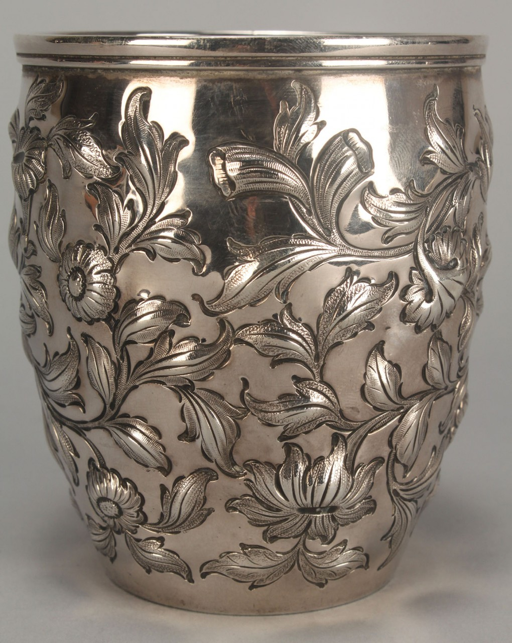 Lot 359: Coin silver repousse tumbler