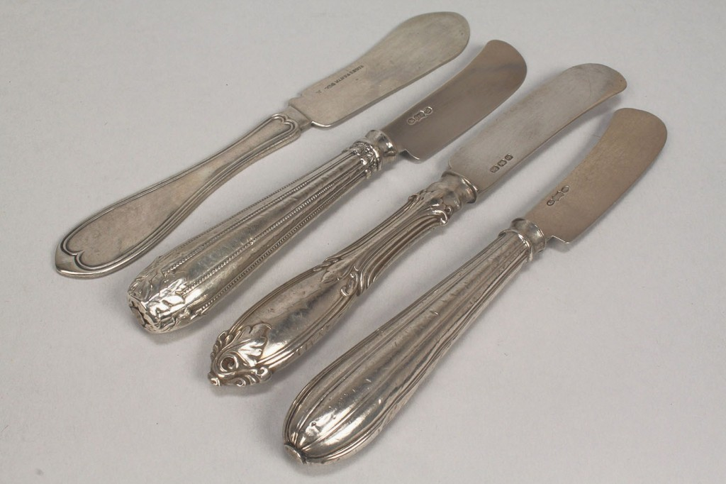Lot 365: 15 coin & early sterling silver knives