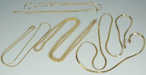 Lot 392: Group of four 14K yellow gold chains