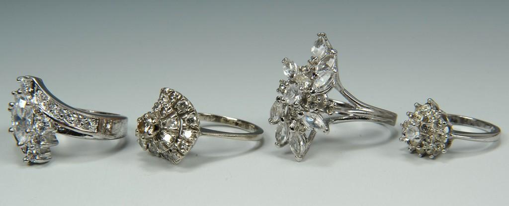 Lot 395: Group of 14K,10K & silver metal diamond rings, 4 t