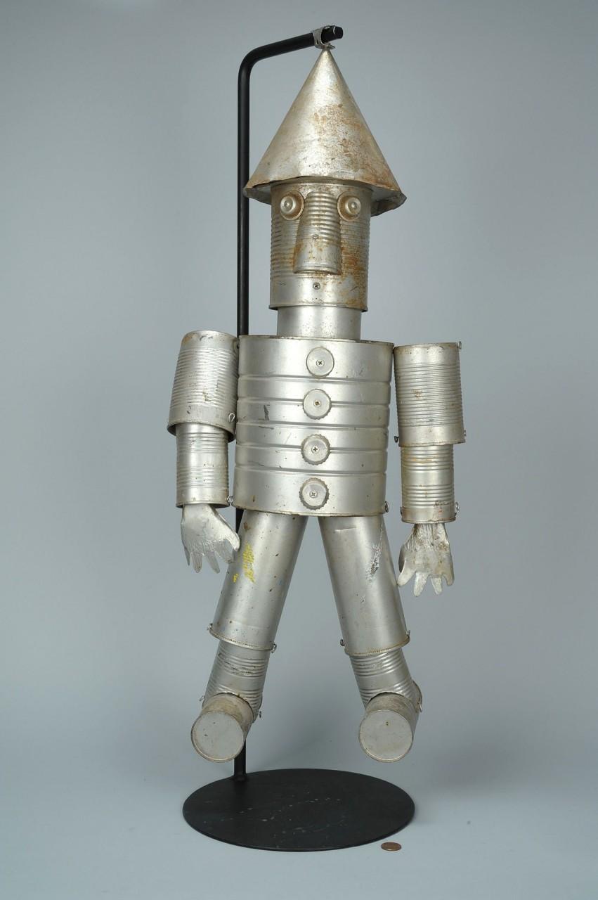 Lot 439: Folk art tin man or robot
