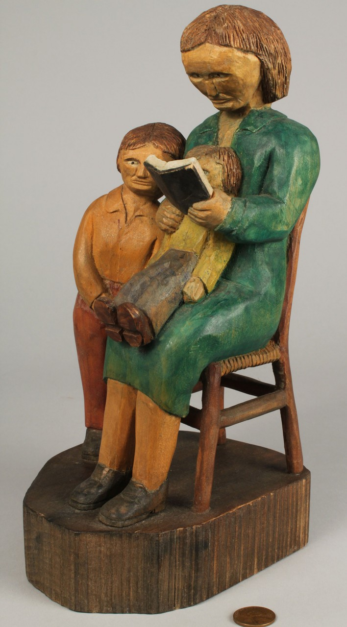 Lot 440: 2 Roy Pace carvings: Gone Fishing and Woman Readin