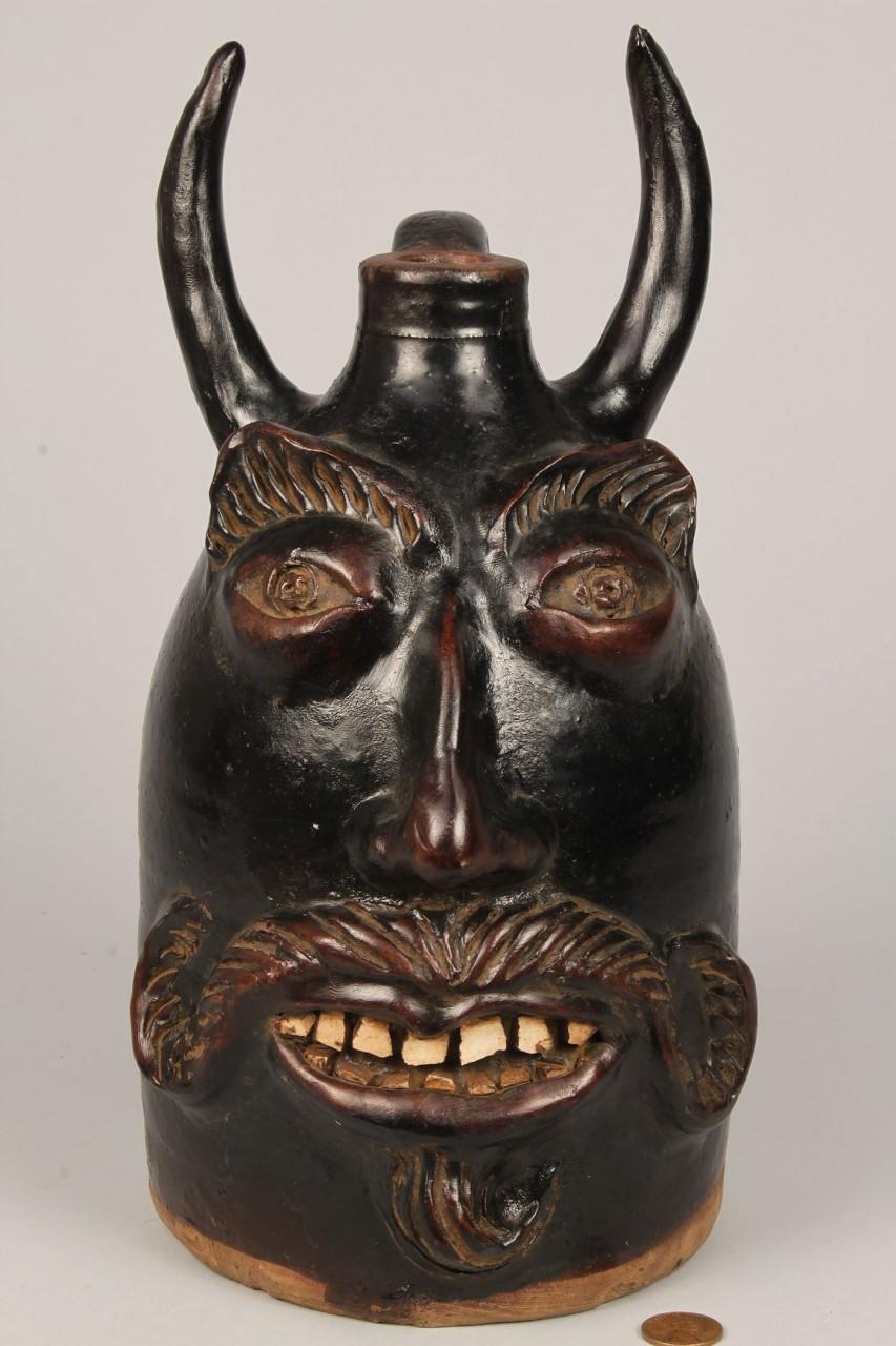 Lot 452: Southern Folk Pottery Devil Face Jug