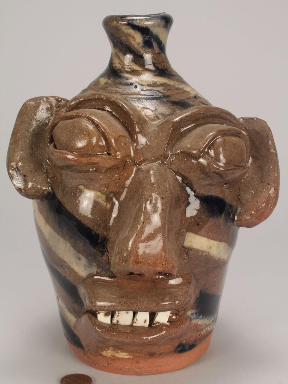 Lot 453: NC Burlon Craig Swirl Pottery Face Jug
