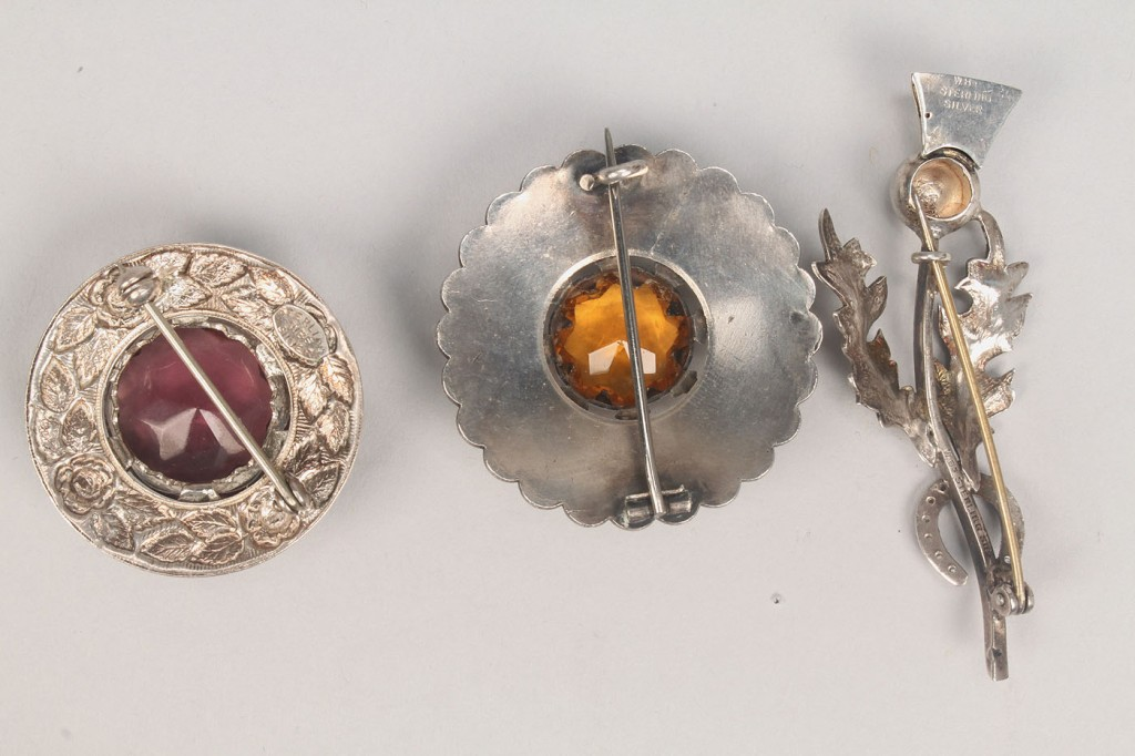 Lot 506: Group of Scottish style jewelry, thistle or stag