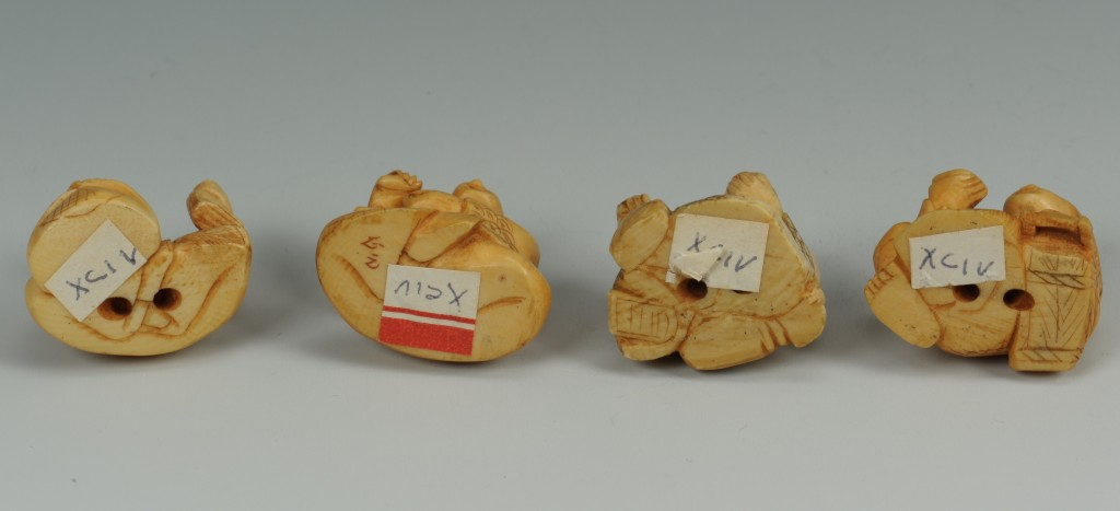 Lot 539: Group of Four stained ivory netsukes