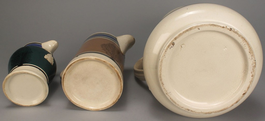 Lot 576: Three Mocha Ware Pitchers with Seaweed Design