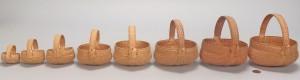 Lot 599: 8 Graduated miniature buttocks baskets