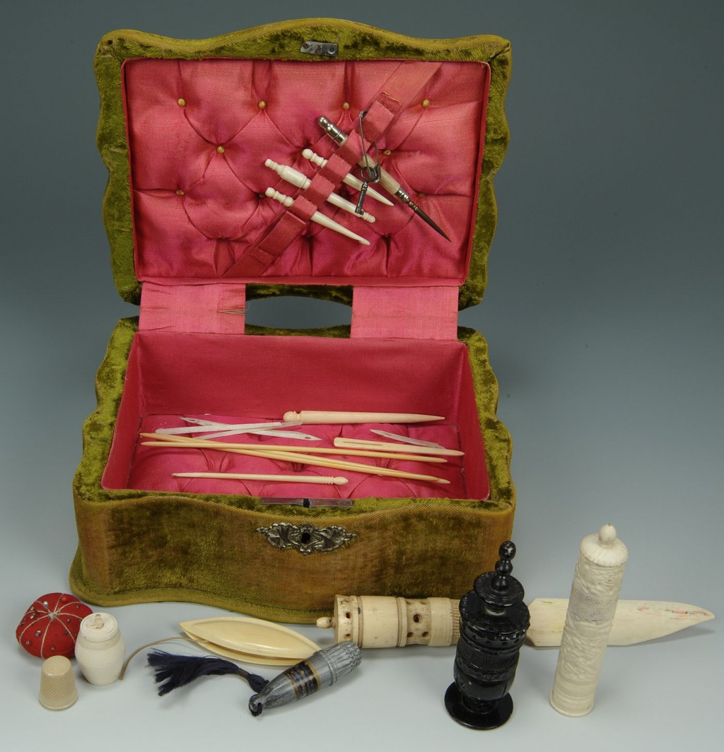 Lot 604: Lot of 22 ivory sewing notions in velvet box