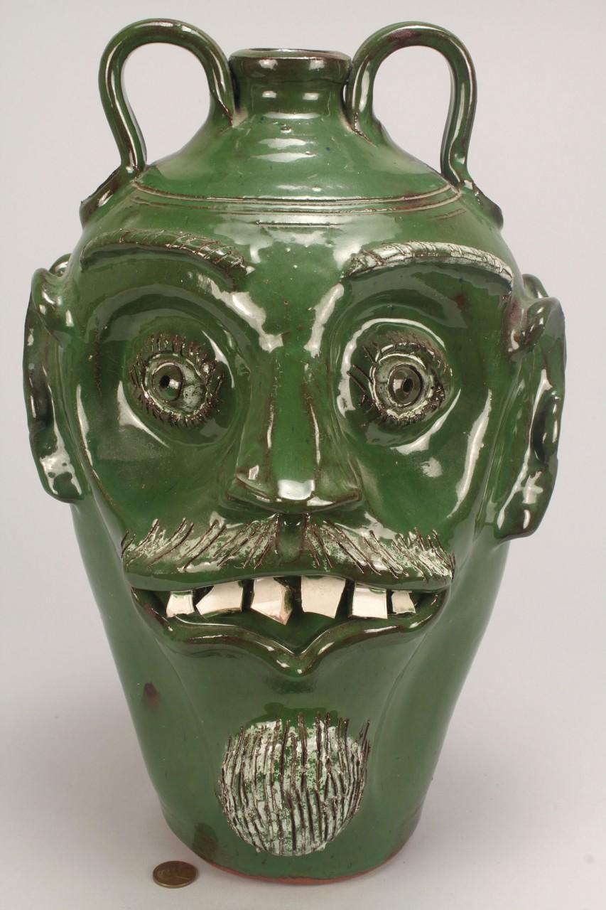 Lot 632: GA folk pottery Double Face Jug