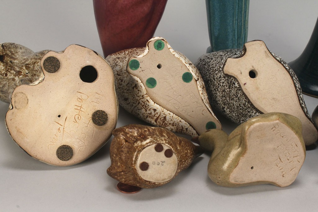 Lot 641: Group of Pigeon Forge Pottery figures, some signed