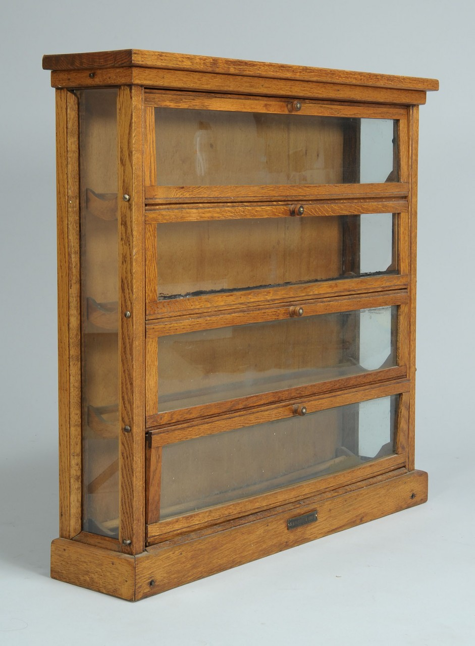 Lot 707: Country store oak counter top ribbon cabinet