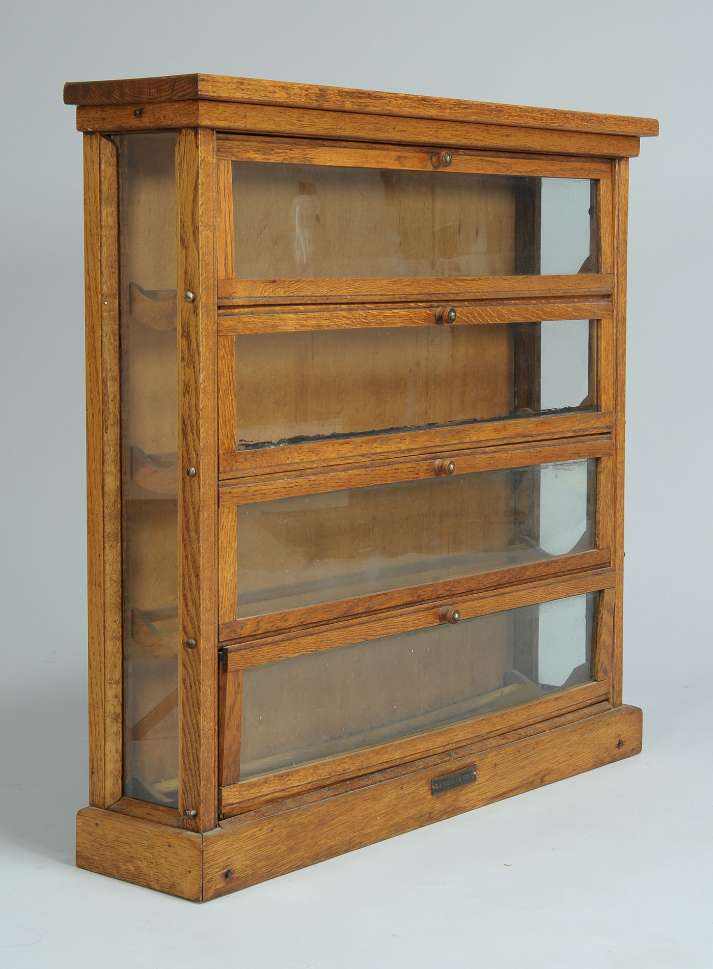 - Lot 707: Country Store Oak Counter Top Ribbon Cabinet