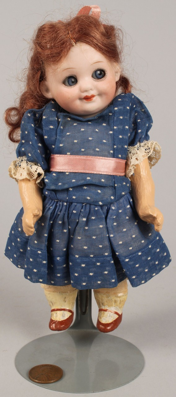 Lot 729: Armand Marseilles Doll w/ Stand