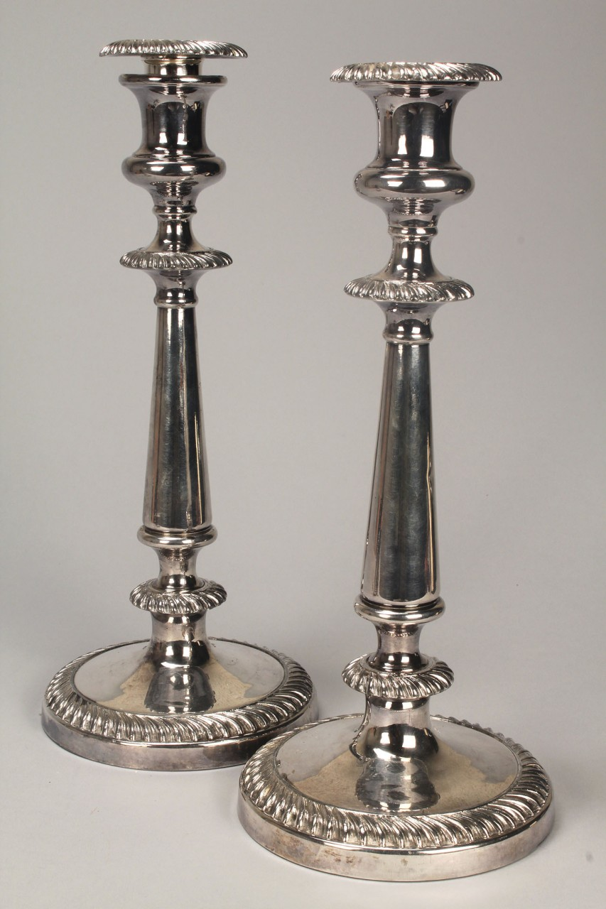 Lot 763: 4 pieces Old Sheffield Plate: candlesticks, knife