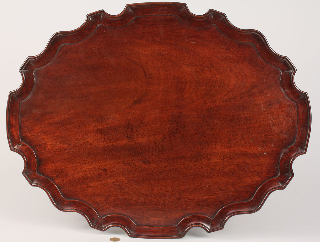 Lot 76: Chippendale mahogany pie crust tea tray