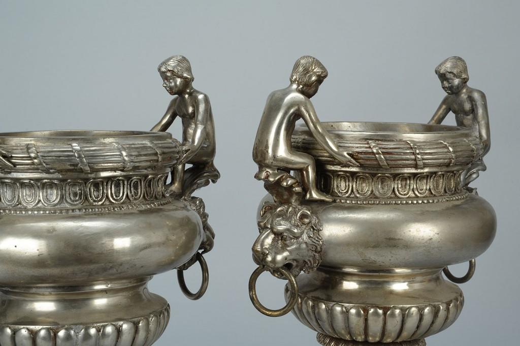 Lot 792: Pair of Lead Garden Urns with Figural Cherub Handl