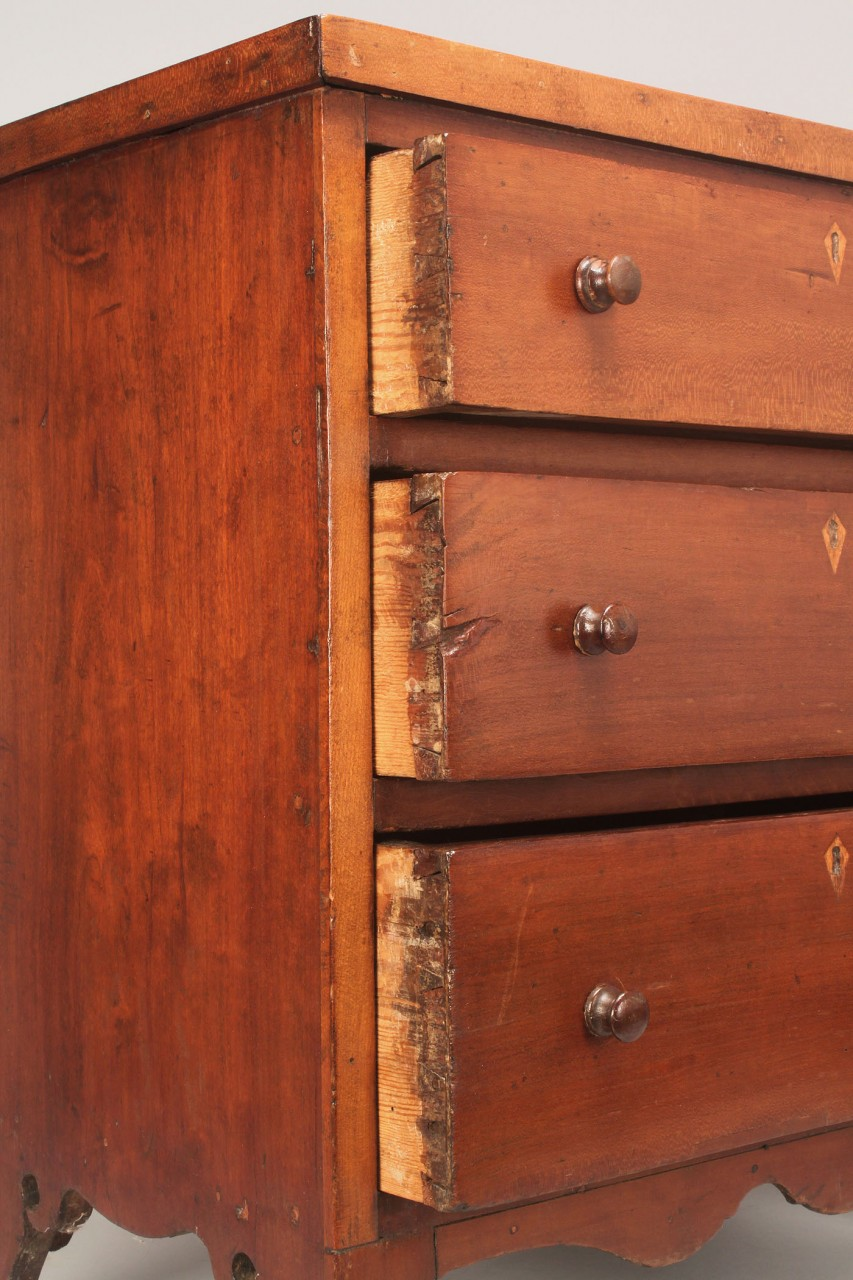 Lot 79: Southern Cherry Miniature Chest of drawers