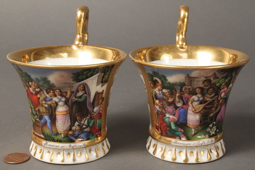Lot 117: Pair of European figural painted teacups and saucers