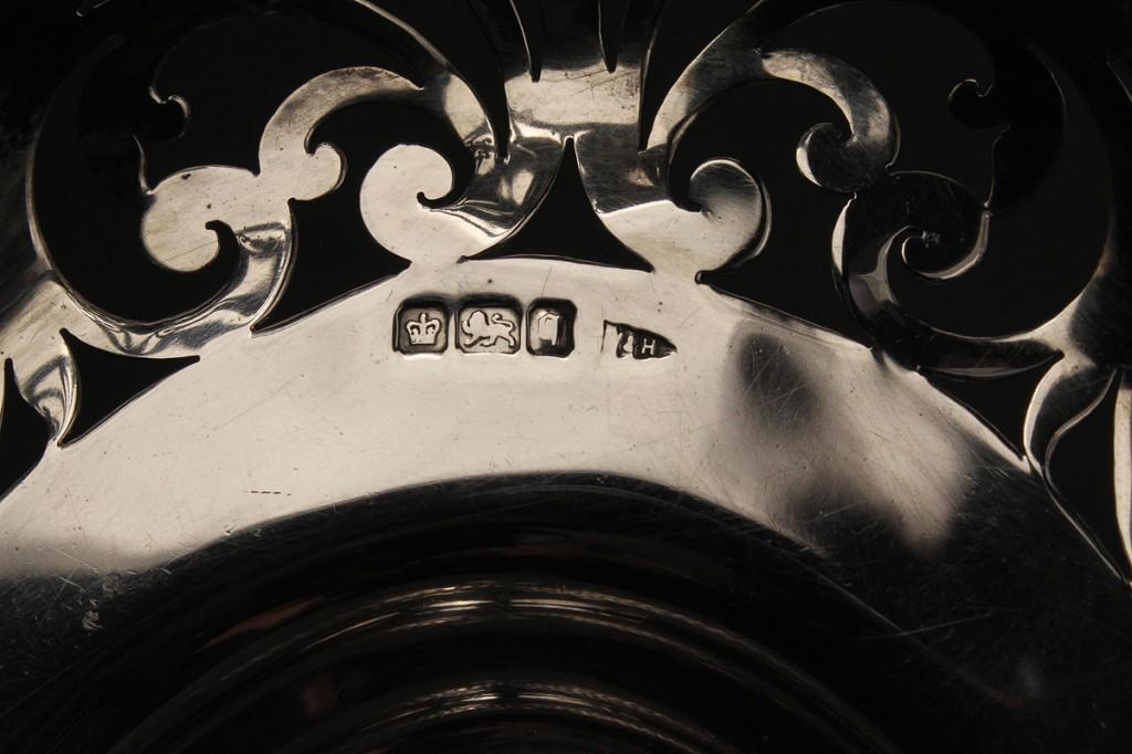 Lot 145: Edwardian Sterling Cake Basket with masks