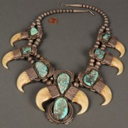 Lot 165: Native American silver and turquoise claw necklace