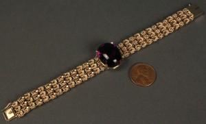 Lot 169: 14K Gold Chain Bracelet w/ purple stone