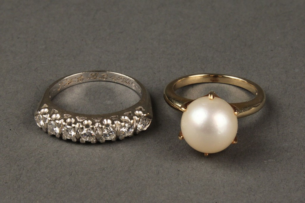 Lot 172: Lot of 2 14K rings. 1 diamond band & 1 pearl ring